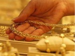 Gold Edges Higher From 8 Month Low On Softer Dollar