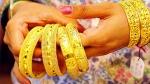 రష్యా వ్యాక్సీన్, లాభాలకు వారు మొగ్గు: ఎగిసి 'పడిపోయిన' బంగారం
