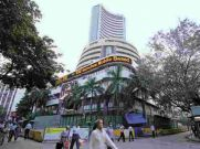 నష్టాల నుండి స్వల్ప లాభాల్లోకి స్టాక్ మార్కెట్లు: