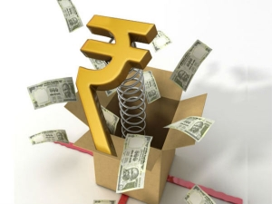 Rupee Rises 14 Paise Against Dollar Early Trade